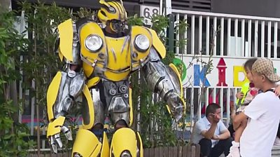 Father dresses as Transformer on son's first day back at school
